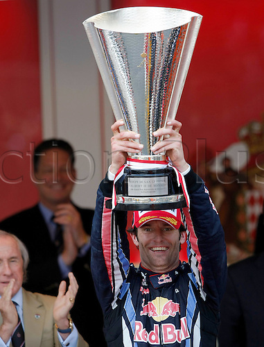 16 05 2010 Formula 1 Grand Prix from Monaco Monte Carlo. Picture shows the cheering from Mark Webber of Red Bull Racing with the winners trophy and with an applauding Stewart in the background