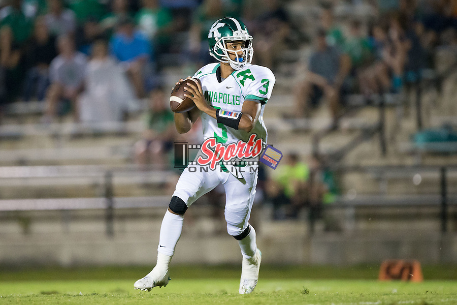 A.L. Brown Wonders quarterback Damon Johnson (3) rolls out to his right looking to pass the football during first half action against the Northwest Cabarrus Trojans at Trojan Stadium September 4, 2015, in Concord, North Carolina.  The Wonders defeated the Trojans 56-7.  (Brian Westerholt/Sports On Film)