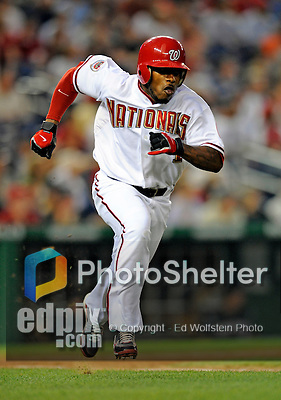 15 August 2008: Washington Nationals' left fielder Willie Harris hustles to first, hitting a double against the Colorado Rockies at Nationals Park in Washington, DC.  The Rockies edged out the Nationals 4-3, handing the last place Nationals their 8th consecutive loss. ..Mandatory Photo Credit: Ed Wolfstein Photo