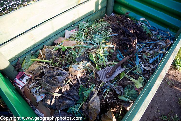 Organic vegetable matter decomposing in compost bin