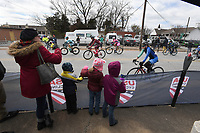 NWA Democrat-Gazette/J.T. WAMPLER Competitors get cheers from a small but vocal crowd during the pro women's race of the criterium portion of the 41st annual Joe Martin Stage Race in downtown Fayetteville Sunday April 15, 2018. The three day event wrapped up Sunday.
