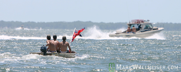 Memorial Day weekend celebrants head out the mouth of the Carrabelle River in all types of boats to attend the annual White Trash Bash at Dog Island off the coast of Carrabelle, Florida May 27, 2007.