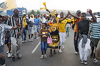 JOHANNESBURG, SOUTH AFRICA - DECEMBER 9: Thousands of soccer fans leave FNB stadium after a derby between local teams Kaizer Chiefs and Orlando Pirates on December 9, 2006 in Johannesburg, South Africa. Soccer is the most popular sport in South Africa, and a because of the upcoming World Cup 2010, the interest is increasing. For the first time the World Cup will be held on the African continent. This was the last game played on the stadium before construction started on the upgrading before the 2010 World Cup. This stadium will be the venue for the World Cup final game. (Photo by Per-Anders Pettersson)....