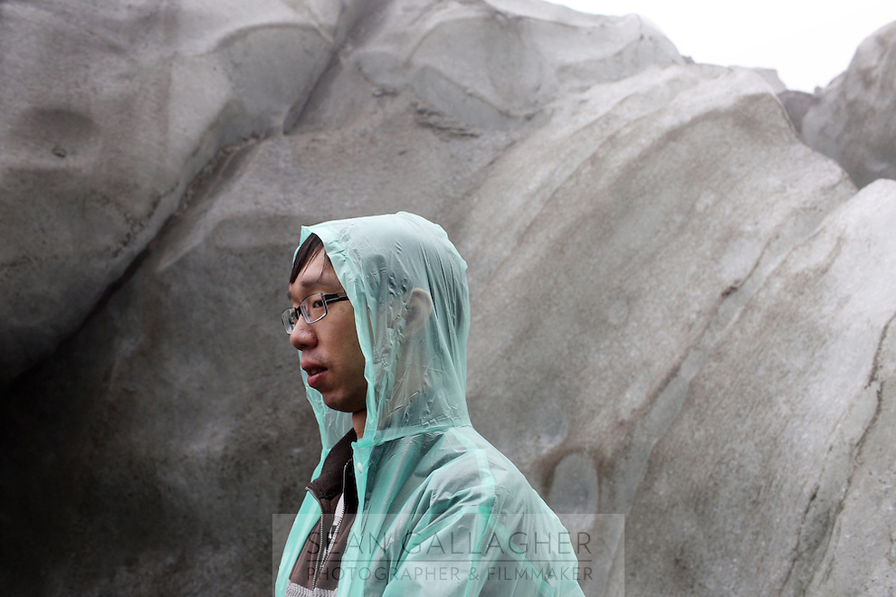 A tourist visiting the Hailuogou glacier in western Sichuan Province, China. As a result of rising temperatures on the Tibetan Plateau, the Hailuogou glacier has retreated over 2 km during the 20th century alone. Since the Little Ice Age, studies have revealed that the total monsoonal glacier coverage in the southeast of the Tibetan Plateau has decreased by as much as 30 percent, causing alarm in scientific circles.