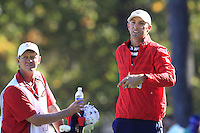 USA Team Player Dustin Johnson and caddy Bobby Brown after winning his match on the 16th green during Sunday's Singles Matches of the 39th Ryder Cup at Medinah Country Club, Chicago, Illinois 30th September 2012 (Photo Colum Watts/www.golffile.ie)
