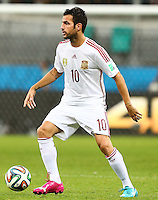Cesc Fabregas of Spain wearing his odd coloured Puma 'evoPOWER tricks' boots