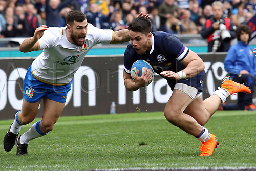 17th March 2018, Stadio Olimpico, Rome, Italy; NatWest Six Nations rugby, Italy versus Scotland; Sean Maitland of Scotland scores a try as Jayden Hayward of Italy tries to stop him