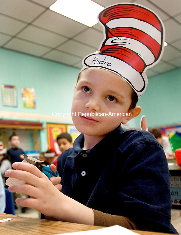 WATERBURY, CT. 02 March 2012-030212SV02-Pedro Iglesias, 6, of Waterbury works on a Dr. Suess art project during a Dr. Celebration at Hopeville School in Waterbury Friday. .Steven Valenti Republican-American