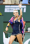 Timea Bacsinszky (SUI) says goodbye to the crowd after her quarterfinal match against Serena Williams (USA). Serena defeated a tough Bacsinszky with a score of 75 63 at the BNP Parisbas Open in Indian Wells, CA on March 18, 2015.