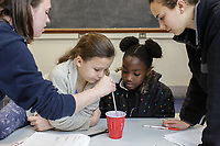 Second from left: Lelia McQuaid, 10 and Ashley Williams, 10, are mentored by Duke students Mallory Hahn (left) and Hannah Berg during a  Duke FEMMES STEM mentoring program at Duke University in Durham, North Carolina, Saturday, February 9, 2019  (Justin Cook)