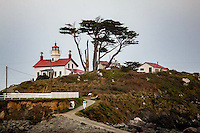 Battery Point Light was one of the first lighthouses on the California coast. Rugged mountains and unbridged rivers meant coastal travel was essential for the economic survival of this region. In 1855, Congress appropriated $15,000 for the construction of a lighthouse on the tiny islet, which is connected to Battery Point by an isthmus which is visible, and can be traversed on foot, at low tide. Although not included in the 1852 contract by the United States Lighthouse Service for the first eight west coast lighthouses, the Battery Point Lighthouse was actually lit ten days before the Humboldt Harbor Lighthouse, the last of the original eight to become operational. The fourth-order Fresnel lens was lit in 1856. The lighthouse was automated in 1953, and a modern 14.8-inch (375 mm) lens replaced the fourth-order Fresnel lens. Theophilis Magruder was the station's first keeper; Wayne Piland was its last before automation in 1953. The 1964 Alaska earthquake, the strongest earthquake ever recorded in the northern hemisphere, caused a tsunami. The lighthouse survived. In the following year, the modern beacon that replaced the Fresnel lens in the tower was switched off, and a flashing light at the end of the nearby breakwater served as the harbor's navigational aid. In 1982, the light in the lighthouse tower was lit again, and the Battery Point Lighthouse was listed as a private aid to navigation.
