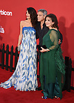WESTWOOD, CA - OCTOBER 22: (L-R) Attorney Amal Clooney, husband/director/producer/screenwriter George Clooney and Amal Clooney's mother Baria Alamuddin arrive at the Premiere Of Paramount Pictures' 'Suburbicon' at Regency Village Theatre on October 22, 2017 in Westwood, California.