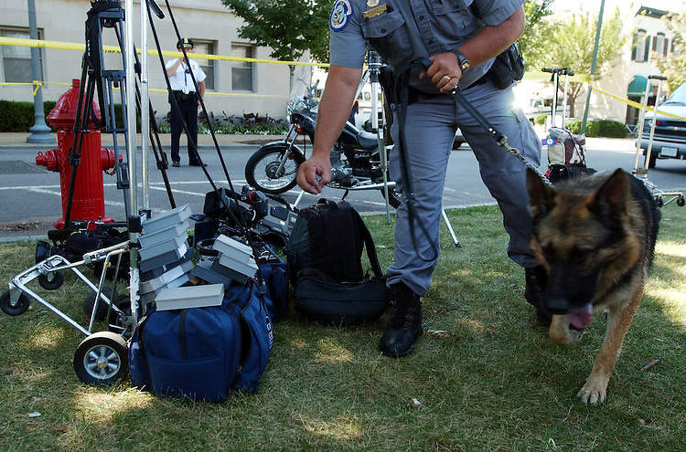13bombings091101 -- Capitol Police with bomb sniffing dogs due sweeps of camera gear after terrorist attacks on New York and Washington DC.