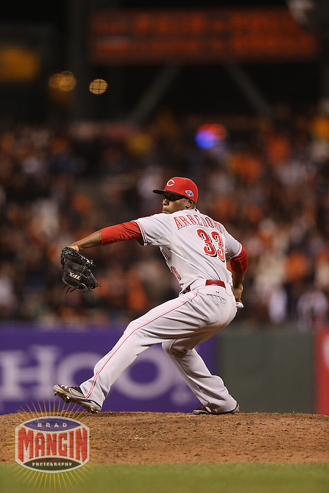 SAN FRANCISCO - OCTOBER 7:  Jose Arredondo of the Cincinnati Reds pitches during Game 2 of the NLDS against the San Francisco Giants at AT&T Park on October 7, 2012 in San Francisco, California. (Photo by Brad Mangin)