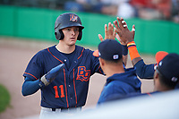 Bowling Green Hot Rods left fielder Beau Brundage (11) is congratulated by teammates after scoring a run during a Midwest League game against the Peoria Chiefs at Dozer Park on May 5, 2019 in Peoria, Illinois. Peoria defeated Bowling Green 11-3. (Zachary Lucy/Four Seam Images)