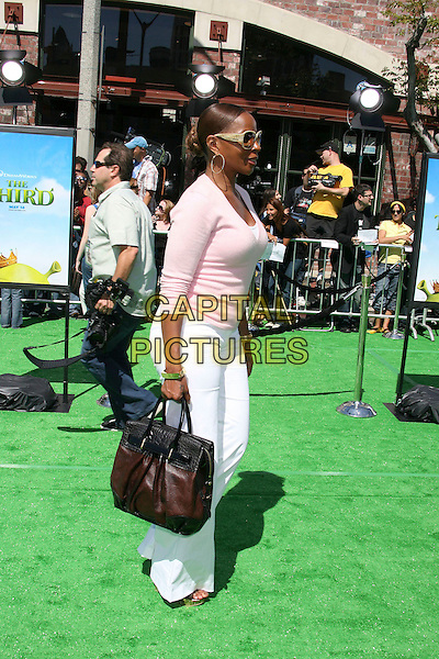 "MARY J. BLIGE.Dreamworks ""Shrek The Third"" Los Angeles Premiere held at the Mann Village Theater, Westwood, California , USA, 06 May 2007..full length  pink top bag white trousers sunglasses profile.CAP/ADM/RE.©Russ Elliot/AdMedia/Capital Pictures."