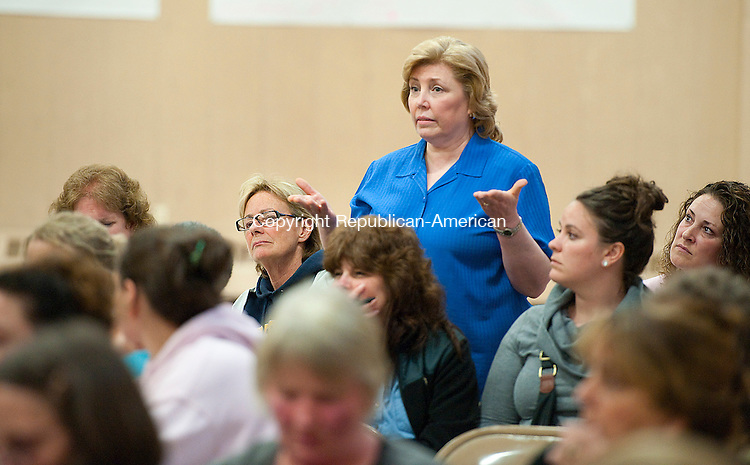 CLEBROOK, CT-052214JS01--Colebrook teacher Marian Pastore asks a question during a public forum on a possible regional elementary school between the towns of Norfolk and Colebrook Thursday at Colebrook Consolidated School. <br /> Jim Shannon Republican-American