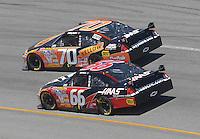 May 6, 2007; Richmond, VA, USA; Nascar Nextel Cup Series driver Johnny Sauter (70) races alongside teammate Jeff Green (66) during the Jim Stewart 400 at Richmond International Raceway. Mandatory Credit: Mark J. Rebilas