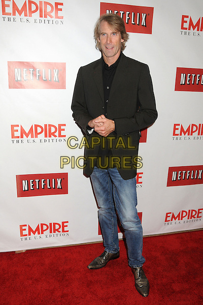 Michael Bay.Empire Magazine Launches Empire U.S. Edition for iPad held at The Sunset Tower Hotel, Hollywood, California, USA..October 2nd, 2012.full length suit jacket jeans denim brown black  .CAP/ADM/BP.©Byron Purvis/AdMedia/Capital Pictures.
