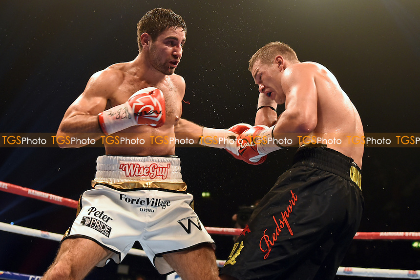 Fedor Chudinov (black shorts) defeats Frank Buglioni during a Boxing Show at Wembley Arena, London, England, promoted by Frank Warren on 26/09/2015
