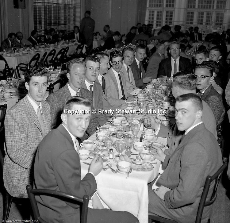 Pittsburgh PA:  View of the Caddies receiving college scholarships from the Western Pennsylvania Golf Association's Caddie Welfare Foundation for year 1958.  The Foundation was managed by Fidelity Trust Company and scholarships are agreed upon by the WPGA executive committee. This dinner was held at the Allegheny Country Club in Sewickley and the assignment was for Charles K. Robinson. The mission of the WPGA are to sanction championships, establish handicapping and rate area golf courses.