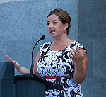 "A small crowd gathered at the State Capitol on Thursday, August 18, 2016 in Sacramento, California to celebrate the 96th anniversary of the ratification of the 19th Amendment to the United States Constitution granting women the right to vote.  Kate Van Buren, Mistress of Ceremony, introduced speakers, Gina Mulligan, author of ""Remember The Ladies"", Angelique Ashby, Sacramento City Council, Nancy Compton, League of Women Voters, Katie McCleary, of 916 Ink and Rachel Michellin of CA Women Lead.  Singer-song writer Virginia Ayers Dawson began the event by singing the National Anthem and as a closing ceremony the group unfurled the banner for the Unity Banner For Hillary Project for a group photograph.  Angelique Ashby, Sacramento City Council member and the only women on the council, speaks to the audience. Photo/Victoria Sheridan 2016"
