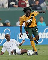 Los Angeles Galaxy's Ugo Ihemelu against New England Revolution's Sharlie Joseph against  July 4, 2005 at The Home Depot Center.