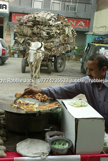 Buffalo cart and mobile street vendor in the Paharganj district of New Delhi in India.