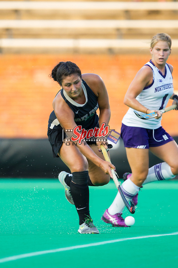 Anna Kozniuk (22) of the Wake Forest Demon Deacons pushes the ball up the field during first half action against the Northwestern Wildcats at Kentner Stadium on September 11, 2014 in Winston-Salem, North Carolina.  The Demon Deacons defeated the Wildcats 1-0.  (Brian Westerholt / Sports On Film)
