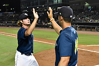 Relief pitcher Matt Blackham (6) of the Columbia Fireflies high fives manager Jose Leger after game two of a doubleheader against the Rome Braves on Saturday, August 19, 2017, at Spirit Communications Park in Columbia, South Carolina. Columbia won, 1-0. (Tom Priddy/Four Seam Images)