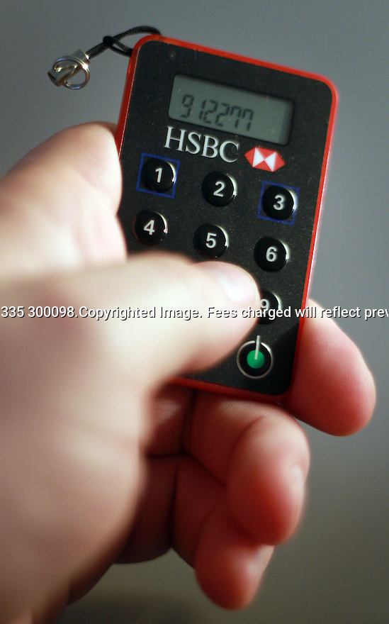 "27/02/2012. TODAY PHOTO...An HSBC customer uses a secure key device to access their online banking...HSBC's annual profits rose 15% to £13.8bn in what it called a year of ""major progress""...The bank is the biggest in Europe and makes about 90% of its profits outside the UK...HSBC's UK profits were 17.2% higher than last year at £1.5bn....All Right Reserved - F Stop Press.  www.fstoppress.com. Tel: +44 (0)1335 300098.Copyrighted Image. Fees charged will reflect previously agreed terms or space rates for individual publications, states or country."