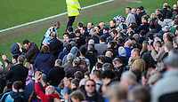 Michael Harriman of Wycombe Wanderers go to talk with fans at the final whistle during the Sky Bet League 2 match between Wycombe Wanderers and Mansfield Town at Adams Park, High Wycombe, England on 25 March 2016. Photo by Andy Rowland.