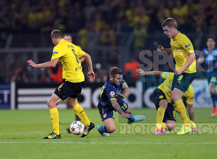 Dortmund's Sven Bender and Matthias Ginter tackle Arsenal's Jack Wilshere<br /> <br /> - Champions League Group D  - Borussia Dortmund vs Arsenal - Signal Iduna Park - Germany - 16th September 2014 - Picture David Klein/Sportimage