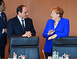 German Chancellor Angela Merkel greets Egyptian President Abdel Fattah al-Sisi as he arrives at the chancellory on the sidelines of a two-day G20 Africa partnership investment conference in Berlin on June 12, 2017. Photo by Egyptian President Office