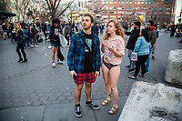 NEW YORK, NY - JANUARY 12: Participants of the No Pants Subway Ride look on at Union square after taking a ride on the NYC subway system on January 12, 2020 in New York. The annual event, in which participants board a subway car in January while not wearing any pants while behaving as though they do not know each other, began as a joke by the public prank group Improv Everywhere in New York City and has since spread around the world, with enthusiasts in around 60 cities and 29 countries across the globe, according to the organization's site.   (Photo by Pablo Monsalve/VIEWpress)