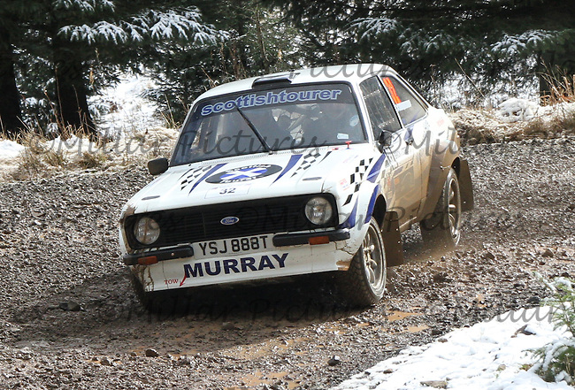 Gordon Murray - Phil Coulby in a Ford Escort Mk 2 at Junction 6 on Special Stage 1 Riccarton on the Brick & Steel Border Counties Rally 2014, Round 2 of the RAC MSA Scottish Rally Championship sponsored by ARR Craib Transport Limited and other championships  and organised by Whickham & District and Hawick & Border Car Clubs and based in Jedburgh and held in Kielder Forest on 22.3.14.