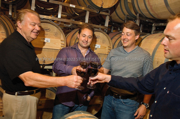7/24/2007--Snohomish, WA, United States..From left to right:  Alex Golitzin, Paul Golitzin,  John Ware, and Marv Crum posing inside the Quilceda Creek Winery, 45 minutes drive north of Seattle, with glasses of their 2004 cabernet sauvignon. One of the earliest producers of cabernet sauvignon there and now one of the best in the country. It's a family operation, run mostly by Alex Golitzin and his son, Paul. Also involved are John Ware and Marv Crum (they are both related to the Golitzin's)...Photograph ©2007 Stuart Isett.All rights reserved
