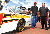 Jul. 3, 2008; Daytona Beach, FL, USA; New England Patriots wide receiver Randy Moss (left) and David Dollar pose for photos after the announcement of his co-ownership of a NASCAR Craftsman Truck Series team and unveiling of the truck prior to practice for the Coke Zero 400 at Daytona International Speedway. Mandatory Credit: Mark J. Rebilas-