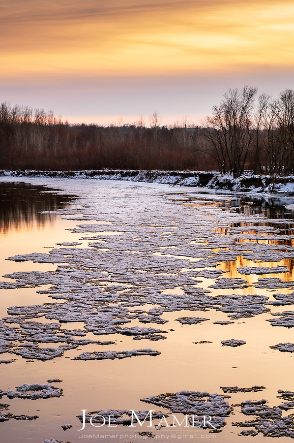 Spring ice flow on the Minnesota River at sunset. The Minnesota River, a tributary of the Mississippi River, flows through the Minnesota Valley River National Wildlife Refuge. The refuge is located within the urban and suburban areas of Minneapolis and St. Paul.