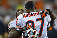 Oct. 16, 2006; Glendale, AZ, USA; Chicago Bears running back (20) Thomas Jones celebrates with wide receiver (87) Muhsin Muhammad after the Bears took the lead in the fourth quarter against the Arizona Cardinals at University of Phoenix Stadium in Glendale, AZ. Mandatory Credit: Mark J. Rebilas