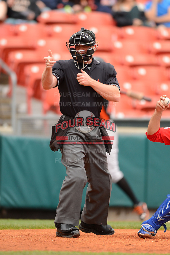 Umpire Toby Basner makes a call during a game between the Buffalo Bisons and Norfolk Tides on May 9, 2013 at Coca-Cola Field in Buffalo, New York.  Norfolk defeated Buffalo 7-1.  (Mike Janes/Four Seam Images)