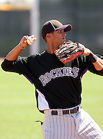 Helder Velazquez #6 of the Colorado Rockies plays in a minor league spring training game against the Arizona Diamondbacks at the Rockies complex on April 1, 2011  in Scottsdale, Arizona. .Photo by:  Bill Mitchell/Four Seam Images.