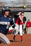 March 10, 2012:   Wisconsin Badgers third baseman Michelle Mueller throws to first against the Nevada Wolf Pack during their NCAA softball game played as part of the The Wolf Pack Classic at Christina M. Hixson Softball Park on Saturday in Reno, Nevada.