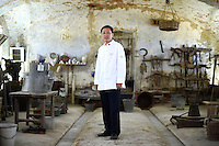 Du Jianlin, Chef to the Great Hall of the People in Beijing China, poses for a portrait in the Cascina Colombara during the annual meeting of the Club des Chefs des Chefs in Livorno Ferraris, Vercelli, Italy, July 18, 2015.<br /> The Club des Chefs des Chefs, which is seen as the world&rsquo;s most exclusive gastronomic society, has extremely strict membership criteria: to be accepted into this highly elite club, you need to be the current personal chef of a head of state. If he or she does not have a personal chef, members can be the executive chef of the venue that hosts official State receptions. One of the society&rsquo;s primary purposes is to promote major culinary traditions and to protect the origins of each national cuisine. The Club des Chefs des Chefs also aims to develop friendship and cooperation between its members, who have similar responsibilities in their respective countries. <br /> The annual meeting of the Club has been hosted this year in the production site of the Italian rice company called Riso Acquerello. <br /> &copy; Giorgio Perottino