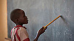 A girl reads words on the chalkboard in a class at the Loreto Primary School in Rumbek, South Sudan. While focused on educating girls from throughout the war-torn country, the school, run by the Institute for the Blessed Virgin Mary--the Loreto Sisters--of Ireland, also educates children from nearby communities.