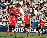 Perry Kitchen #5 of the University of Akron wins a header against Andrew Farrell #5 of the University of Louisville during the 2010 College Cup final at Harder Stadium, on December 12 2010, in Santa Barbara, California. Akron champions, 1-0.