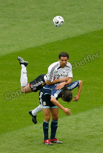 Jun 30, 2006; Berlin, GERMANY; Germany defender (21) Christoph Metzelder jumps over Argentina forward (9) Hernan Crespo for the ball during first half play in quarterfinal action of the 2006 FIFA World Cup at Olympiastadion, Berlin. Mandatory Credit: Ron Scheffler-US PRESSWIRE Copyright © Ron Scheffler.