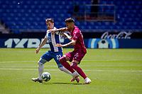 13th June 2020, Barcelona, Spain; La Liga football, RCD Espanyol versus Alaves;  RCD Espanyols Adrian Embarba Lgrapples with Victor Camarasa of Alaves