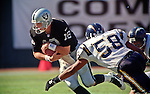Oakland Raiders vs. San Diego Chargers at Oakland Alameda County Coliseum Sunday, October 11, 1998.  Raiders beat Chargers  7-6.  Oakland Raiders quarterback Donald Hollas (12) attempts to get away from San Diego Chargers linebacker Lewis Bush (58).