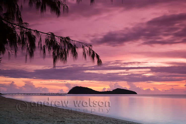 View along Palm Cove beach to Double Island at dawn.  Palm Cove, Cairns, Queensland, Australia